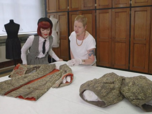 Amber Butchart and Susan North with an original 17th century suit at the V&A
