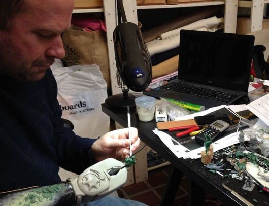 Michael Perry at work on miniatures